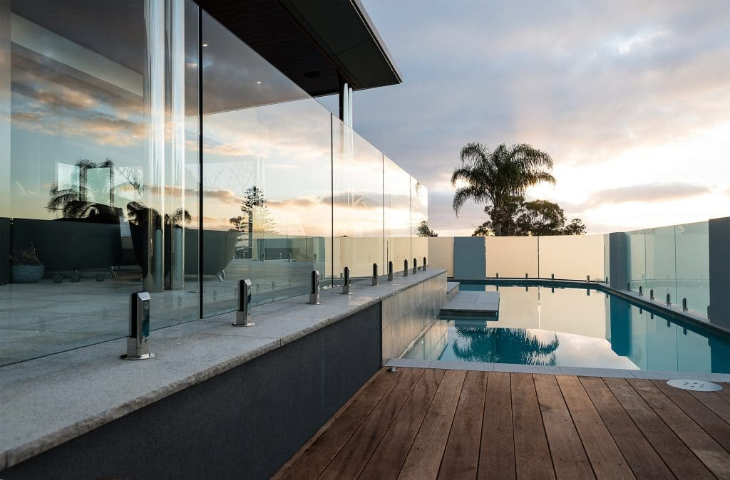 Frameless glass pool fencing with toughened glass