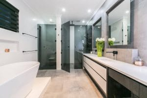 Fully frameless shower screen with grey glass