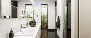 Slim line framed mirrors in bathroom